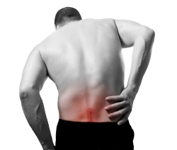 patient with lower back pain needing chiropractic treatment in New Albany